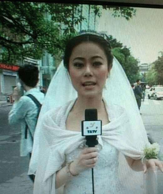 """雅安""""最美新娘""""女记者穿婚纱报道地震事迹材料"""